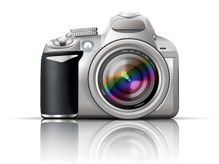 photographic: gray slr camera on a white background with the reflection of the