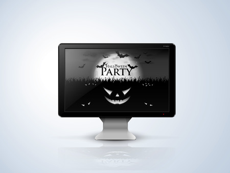 silver plate: black computer monitor on the silver plate with    depicting scenes of Halloween screen