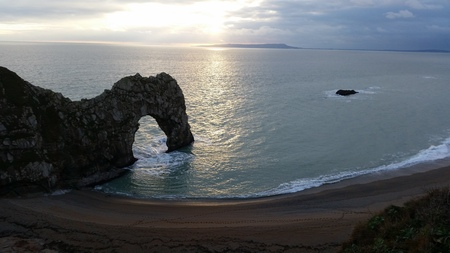 jurassic coast: Sunset at Durdle Door natural arch linestone on the Jurassic Coast in Dorset England UK Europe Stock Photo