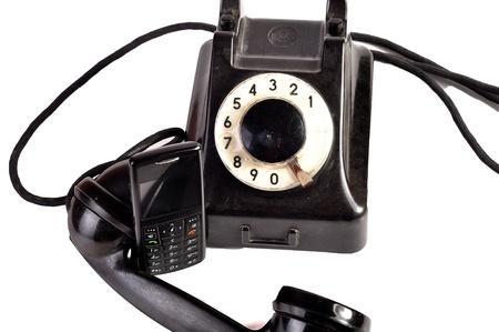 Photo of modern phone and old phone compared with themselves. Stock Photo - 10050071