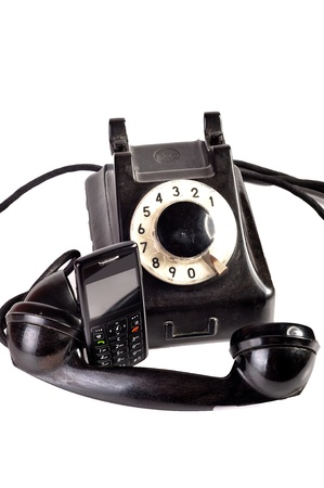 Photo of modern phone and old phone compared with themselves. Stock Photo - 10415764