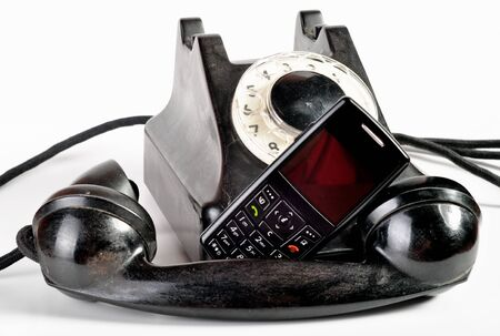 modern phone and old phone compared with themselves. Stock Photo - 10445257
