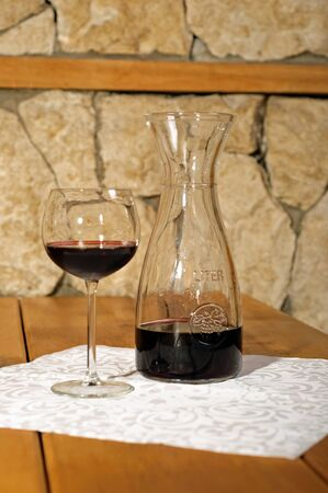 Photo of glass of red wine.