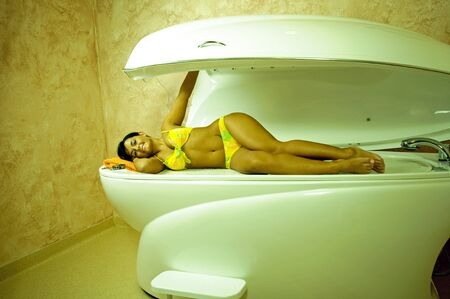hydromassage: Young beautiful woman lying in spa.