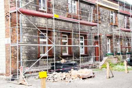 old building facades: Photo of building with scaffolding during renovation Stock Photo