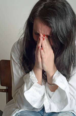 image of a weeping woman desperate