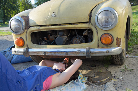 operating key: a photo of a woman car mechanic Stock Photo