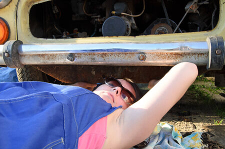 a photo of a woman car mechanic photo