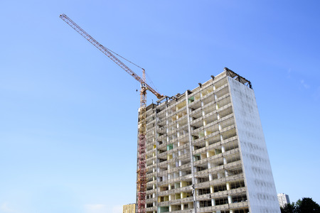 disassemble: photo showing the demolition of a skyscraper with a high crane