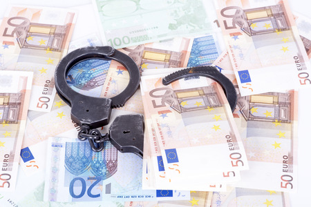 photo showing money with handcuffs Stock Photo