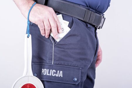 bribes: accepting bribes by corrupt Polish policeman