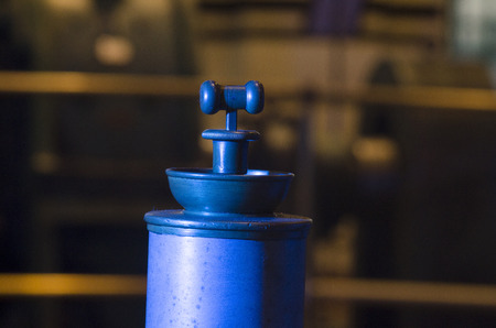 postproduction: photo of the historic machines in macro photography, detail,the color of the object obtained by lighting in the shooting phase and not in the post-production
