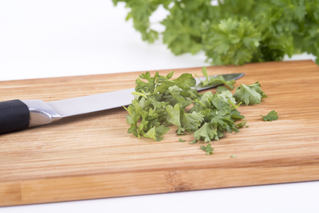 twing: a photo of parsley on a chopping board cookery Stock Photo