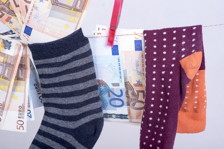 frugal: photo showing the savings in euros hidden in a sock