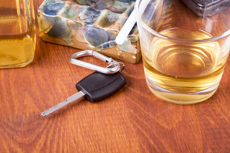 equals: a photo of alcohol, car keys which equals tragedy on the road