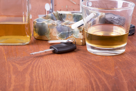 a photo of alcohol, car keys which equals tragedy on the road