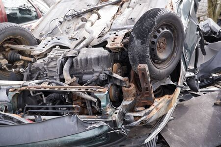 photo showing the heavily crashed car in a road accident