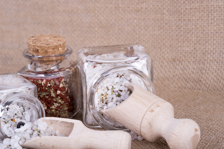 image of table salt in a measuring cup herbal against other spice Stock Photo