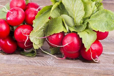 radishes: a photo of fresh red radishes