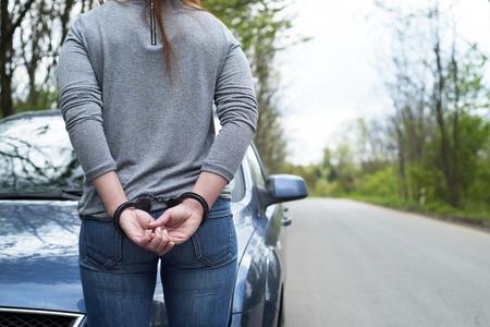 handcuffed: Photo of women handcuffed criminal police Stock Photo