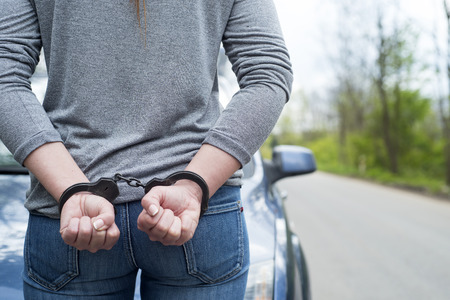 criminal: Photo of women handcuffed criminal police Stock Photo