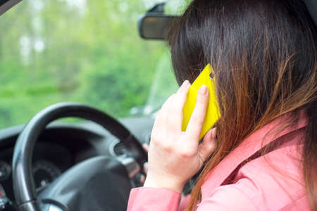 dissociation: image depicting a woman riding in a car and talking on the phone