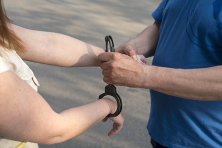 criminal: Photo of women handcuffed criminal police Stock Photo