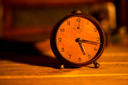old alarm clock on background Stock Photo
