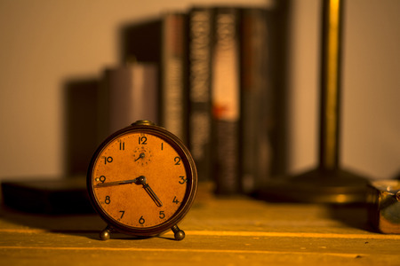 incentives: old alarm clock on background Stock Photo