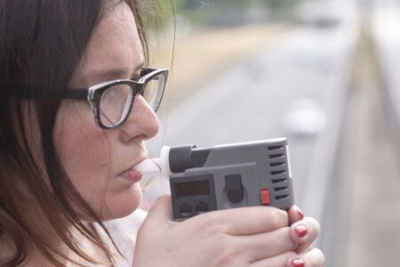woman investigating on alkom alcohol level Stock Photo