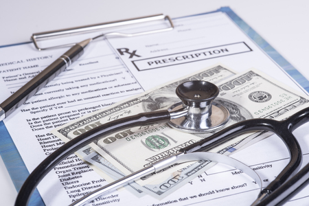 Medical history questionnaire and money Stock Photo