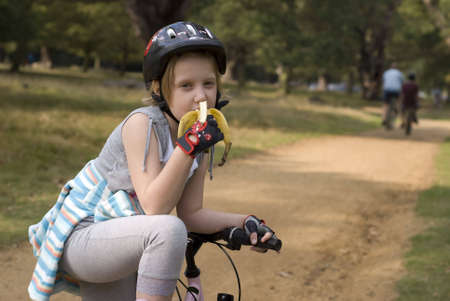 Free time in park, girl end bike Stock Photo