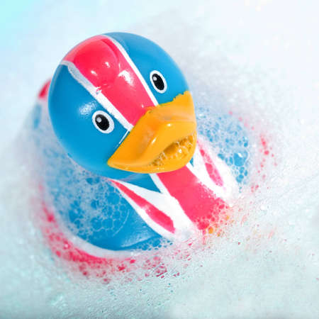rubber duck against a bubbly blue background Stock Photo - 4162256