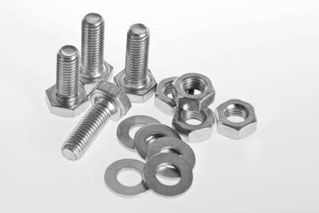 Bolts, screws and nuts on a white background Stock Photo