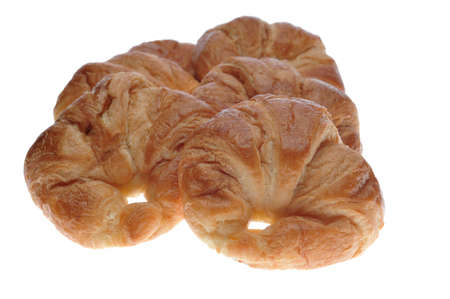 Golden flakey delicious baked croissant on a white background Stock Photo