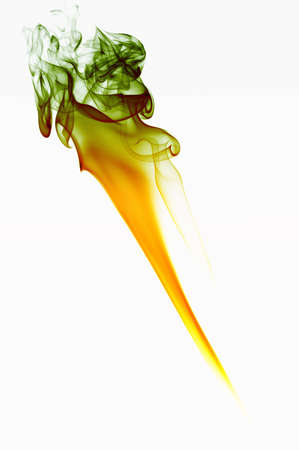 Abstract colourful art created from candle smoke against a white background