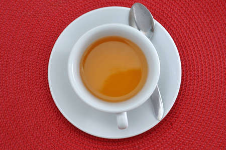 Cup of tea photo with red background