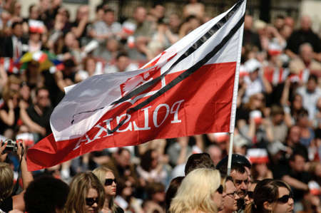 London - APRIL 18: Poland mourns the victims of a plane crash near Smolensk in which the Polish president Lech Kaczynski was killed with his wife Maria Kaczynska. April 18, 2010 in London, UK  To many Polish people common to Trafalgar Sqare in London.Ph