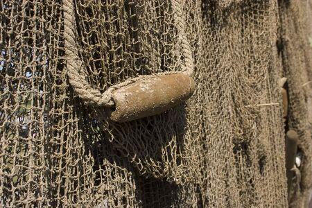 fishing net dries in the sun photo