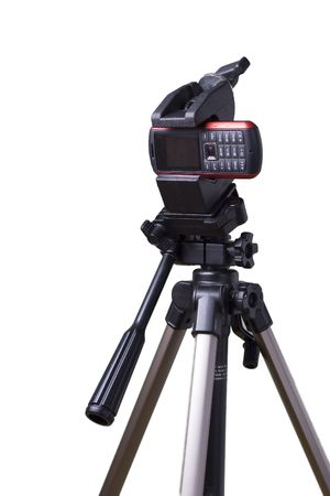 mobile phone attached to the camera tripod photo