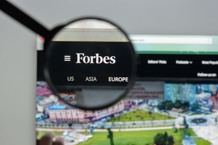 Milan, Italy - August 10, 2017: Forbes website homepage. It is an American business magazine. Forbes.com logo visible.