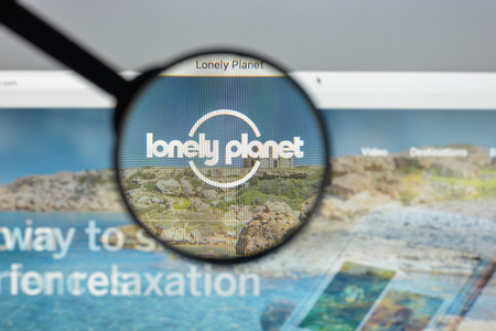Milan, Italy - August 10, 2017: Loney Planet website homepage. It is the largest travel guide book publisher in the world. Loney planet logo visible.