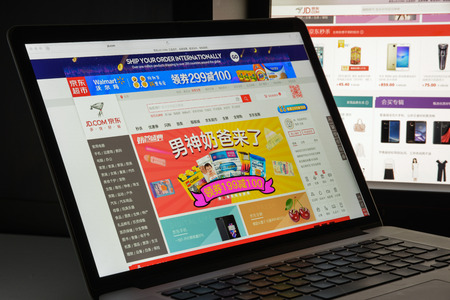 Milan, Italy - August 10, 2017: jd.com website homepage. It also known as Jingdong and formerly called 360buy, is a Chinese e-commerce company headquartered in Beijing. JD logo visible.