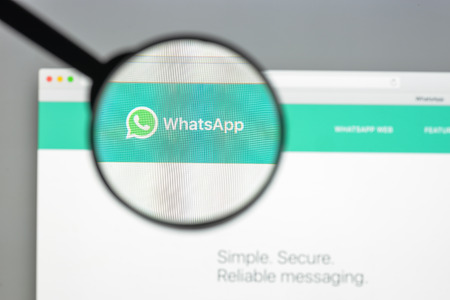Milan, Italy - August 10, 2017: Whatsapp website homepage. It is a freeware and cross-platform instant messaging service for smartphones. Whatsapp logo visible.