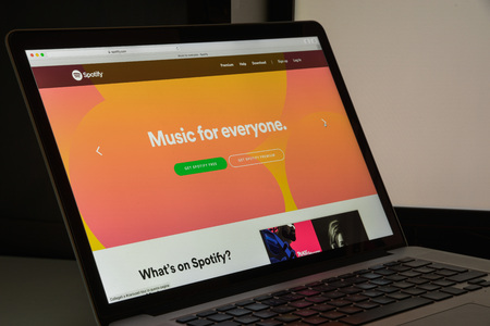 Milan, Italy - August 10, 2017: Spotify website homepage. It is a music, podcast, and video streaming service. Spotify logo visible.