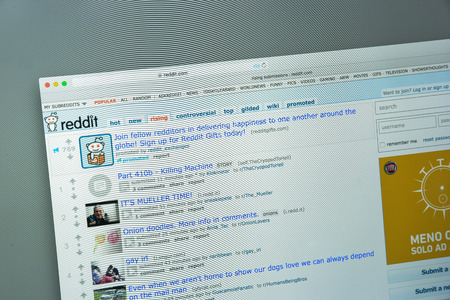 Milan, Italy - August 10, 2017: Reddit website homepage. It is an American social news aggregation, web content rating, and discussion website. Reddit logo visible.