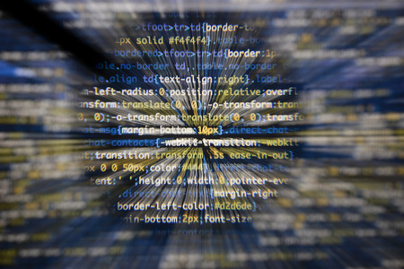 Real css code developing screen. Programing workflow abstract algorithm concept. Lines of css code visible under magnifying lens with moviment effect. Stock Photo