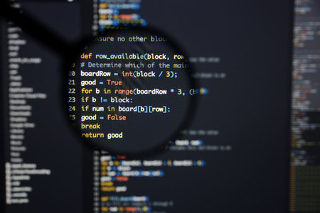 Real Python code developing screen. Programing workflow abstract algorithm concept. Lines of Python code visible under magnifying lens. Foto de archivo