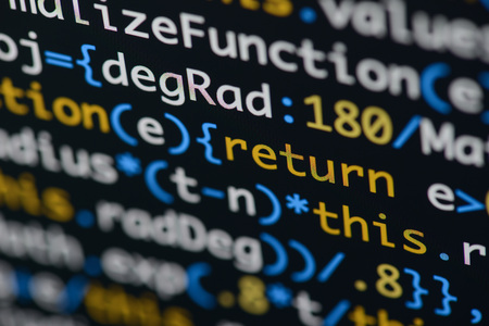 Real Java Script code developing screen. Programing workflow abstract algorithm concept. Closeup of Java Script and HTML code. Stock Photo