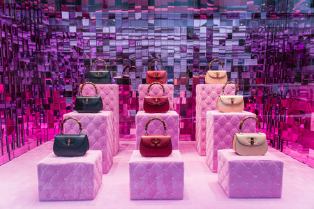 Milan, Italy - February 28, 2017: Shop window of a Gucci shop in Milan - Montenapoleone area, Italy. Few days after Milan Fashion Week. Gucci Bags Spring Summer 2017 Collection. Editorial